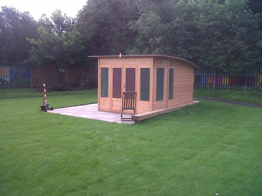 new lawn and wooden hut